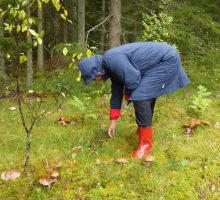Gummistiefel – und Regenmantel