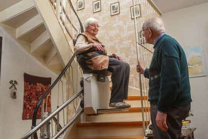 elderly couple at the stairlift