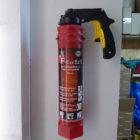 Feuerlöscher in Wandhalterung